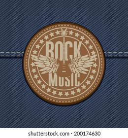 banner with the emblem of rock music and the guitar on the background of denim