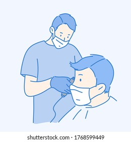 Barber is cutting the hair of a man and they wearing PPE for protection coronavirus.