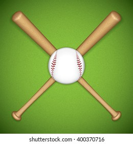 Baseball leather ball and wooden bats on green background