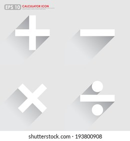 Basic mathematical symbols - plus, minus, multiplication & division - on gray background