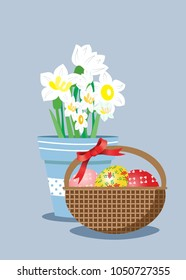 Basket with Easter eggs and potted daffodils