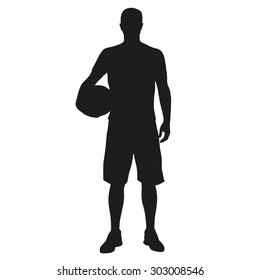 Basketball player standing with ball in hand. Vector silhouette of sportsmen with a ball