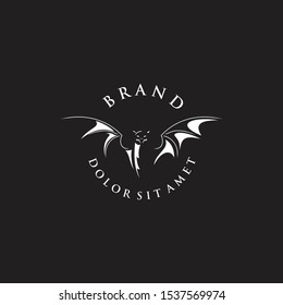 bat Logo Design Template Vector with a black background