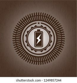 battery charging icon inside wooden emblem