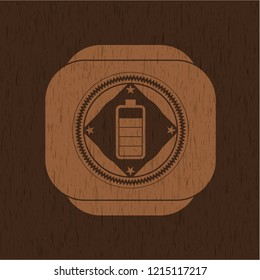 battery icon inside badge with wooden background