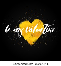 be my Valentine hand lettering - hand made calligraphy in modern style. Write with brush. Text over heart shape with gold foil texture. Black background