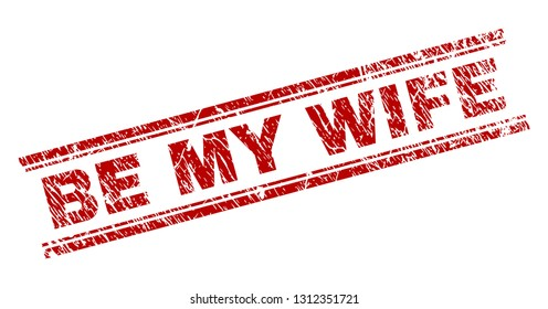 BE MY WIFE seal imprint with corroded effect. Red vector rubber print of BE MY WIFE caption with corroded texture. Text caption is placed between double parallel lines.