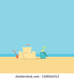 Beach ball and a bucket with a shovel on sea background.