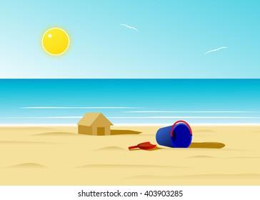 beach. A sand house on the beach against the blue sea and the sky.