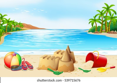 Beach scene with sand castle and objects