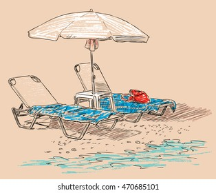 beach umbrella and sunbeds on the seashore
