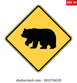 Bear crossing warning road sign. Caution big animals. Vector illustration of yellow diamond shaped traffic sign with bear icon inside. Risk of collision. Wildlife on road symbol.