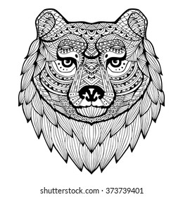 Bear head in style zentangle. Patterned bear's head on the grunge background. African, indian design. It may be used for design of a t-shirt, bag, postcard, a poster and so on. Logo. Icon. Monochrome.