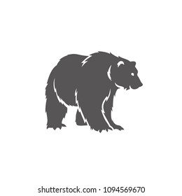 Bear silhouette isolated on white background vector illustration. Standing bear vector graphic emblem.