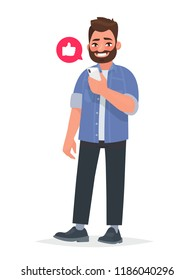 Bearded man is holding a smartphone in his hand. Communication in the network, dating sites and social networks. Addiction on gadgets. Vector illustration in cartoon style