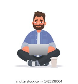 Bearded man sits on the floor and works at a laptop. Remote work via the Internet. Freelancer. Vector illustration in cartoon style
