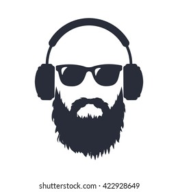 Bearded man in sunglasses and headphones