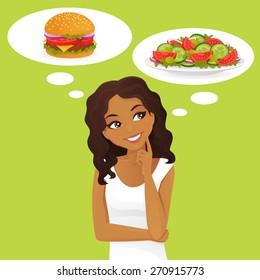 Beautiful black woman choosing between salad and hamburger, healthy and junk food.