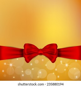 Beautiful  and bright red bow on the golden  holiday background