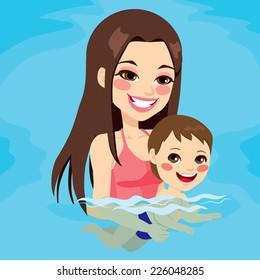 Beautiful brunette mom at swimming pool teaching her baby boy how to swim