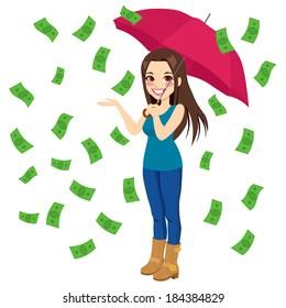 Beautiful brunette woman holding big umbrella happy seeing raining money bills