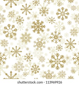 Beautiful Christmas background. Golden snowflakes on white background. Vector seamless pattern. May be used as gift paper