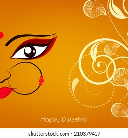 Beautiful face of hindu mythological Goddess Durga with big eyes on floral decorated yellow background for Dussehra festival celebrations.