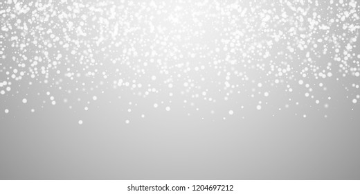 Beautiful falling snow Christmas background. Subtle flying snow flakes and stars on light grey background. Adorable winter silver snowflake overlay template. Cute vector illustration.