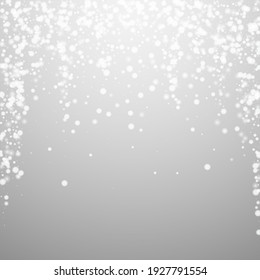 Beautiful falling snow Christmas background. Subtle flying snow flakes and stars on light grey background. Admirable winter silver snowflake overlay template. Ecstatic vector illustration.
