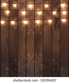 Beautiful fanciful hand drawn doodle oriental ornament and lighting garland festive decoration, on wooden realistic background with space for text. Can be used for greeting, invitation or post card