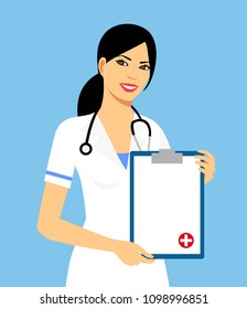 Beautiful female nurse is holding clipboard and showing document. Portrait of young nurse or medic with clipboard and stethoscope isolated on blue background