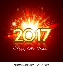 Beautiful fireworks with a bright flash of light with greetings Happy New Year! and gold number 2017