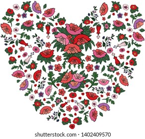 Beautiful floral heart made of red and pink poppies and tulips isolated on white.