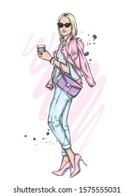 Beautiful girl with a bob hairstyle in a stylish jacket, jeans and high-heeled shoes. Woman with a glass of coffee. Fashion and style, clothes and accessories. Vector illustration for a card or poster
