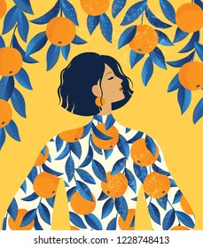 Beautiful girl in a dress with oranges pattern print and orange tree background.