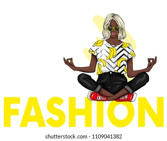 A beautiful girl in jeans and a top is sitting in a stylish inscription in a yoga pose. Vector illustration. Clothes and accessories. Print on clothes. Fashion & Style. Fashionable look. Black woman.