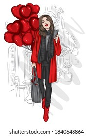 A beautiful girl in a stylish coat, scarf, jeans and boots. Fashionable clothes and accessories, fashion and style. Heart shaped balloons. Valentine's Day.