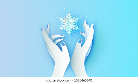 Beautiful girl's hand holding snowflake floating in hand. Women and snowflake. Graphic design for winter. paper cut and craft style. vector, illustration.