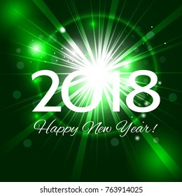 Beautiful green holiday background abstract fireworks with a bright flash of light and the greetings  Happy New Year 2018!