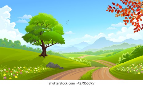 A beautiful green tree along a road across lush grasslands