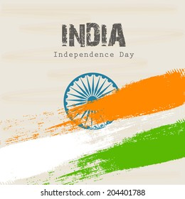 Beautiful greeting card design with national flag colors and ashoka wheel on brown background for 15th of August, Independence Day celebrations.