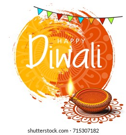Beautiful greeting card for festival diwali celebration with creative festive background and decoration with Traditional floral diya / lit lamp and Floral Rangoli can be used as card, banner poster