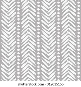 Beautiful hand drawn pattern in bohemian style. Abstract background with brushed stripes and dots. Classic elegant texture in white and grey. Vector seamless texture for your design
