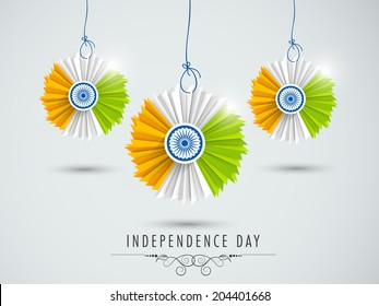 Beautiful hanging decorative in Indian National Flag colors on grey background for 15th of August, Independence Day celebrations.