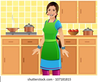 Beautiful Indian woman in a Salwar kameez and apron in kitchen
