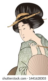 Beautiful Japanese woman in her traditional clothes holding a fan
