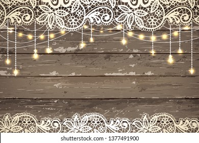 Beautiful lace with decorative lights. Vintage wooden background. Inspiration card for wedding, date, birthday, tea or garden party
