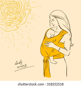 Beautiful mother with baby in a yellow wrap sling.