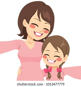 Beautiful mother and daughter happy making selfie together with same pink shirt