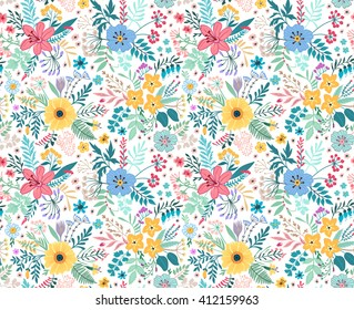 Beautiful pattern in small abstract flower. Small colorful flowers. White background. Spring floral background. The elegant the template for fashion prints.